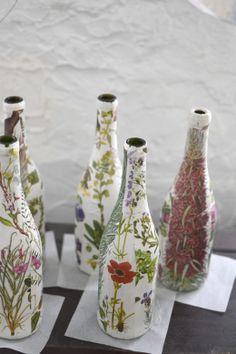 Decoupage wine bottles in progress by Insitu Decorative Arts