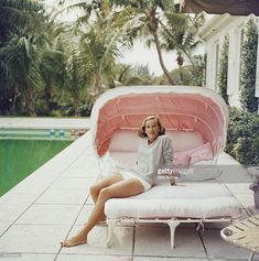 Socialite Alice Topping relaxing by a swimming pool in Palm Beach, Florida, 1959.