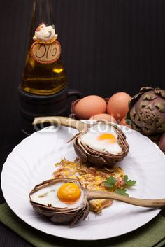 Stylish Breakfast with eggs baked in artichokes!  Check it at Fotolia!
