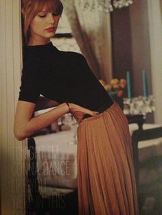 Black mock turtleneck with pleated skirt