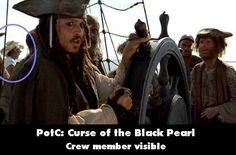 Movie Mistake: Pirates of the Caribbean: The Curse of the Black Pearl you can see a crew member behind Jack Sparrow in a cowboy hat looking out to sea #Oops