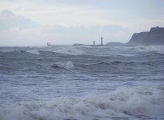 Whitby lighthouse from Sandsend beach