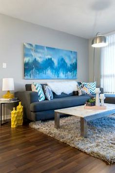 horizontal art above the couch - a perfect example of how to do large art in a small room