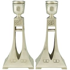 A pair of Art Nouveau WMF Candlesticks ca. 1906 A pair of candlesticks with geometrical forms by WMF. Candelabra, Candlesticks, Art Nouveau, Antique Collectors, Red Louboutin, Light My Fire, Wmf, Jewish Art, Candle Centerpieces