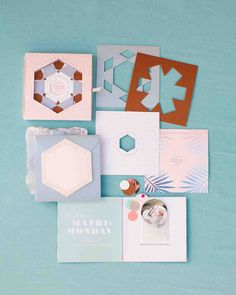 11 Unexpected Winter Wedding Invitations | Martha Stewart Weddings - Inspired by kaleidoscopes, stationer Cheree Berry designed this suite for a Palm Springs wedding in February that came in a box full of die-cut, foil-stamped papers that relayed all the relevant information in cool shades of winter pastels.