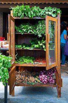 Armoire of fresh herbs... what a lovely photo & great idea for a farmer's market display!