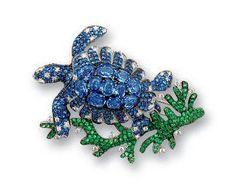 $4,000.00. A sapphire, tsavorite garnet and diamond brooch