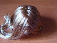 Glue and criss cross part method wig making tutorial. By: Lany.