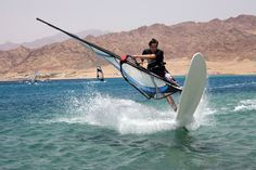 *EGYPT ~ Windsurfing off Dhab, Red Sea, Egypt.  the Red Sea gets almost certain sunshine all day long, some warm waters outside mid-winter, healthy coral formations and marine life coupled with modest prices, and some fair beaches – ironically in this country that's 98% desert the sand is coarse and beaches tend to be small. The best beaches are artificial and mostly on the mainland (Hurghada) side.