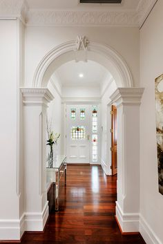 white hall and stained glass~I would love stained glass in my future home. :)