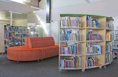 Library seating with curved melamine shelving