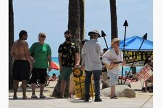 Demonstrators spent Saturday planting coconut trees and waving signs in rallies across the #Hawaiian Islands as part of an international day of #protests against agriculture business #Monsanto. #GMO #food