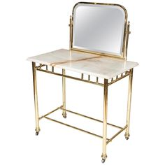 An Edwardian brass dressing table with marble top, circa 1910. 1