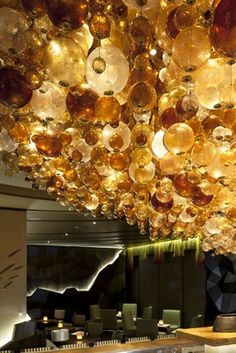 These various shaped globes in various shades of color make for luxurious lighting. A Nobu Perth lighting design.