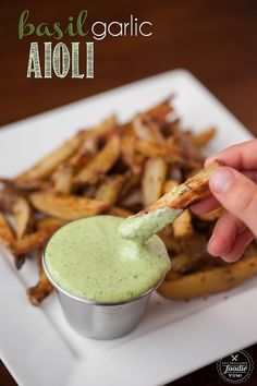 Making homemade Basil Garlic Aioli from scratch only takes a few minutes and the result is a flavorful dip or spread that packs a real raw garlic punch.