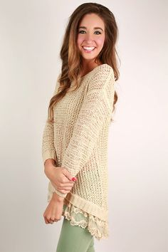 This long sweater has just the right amount of lace detail to make ...