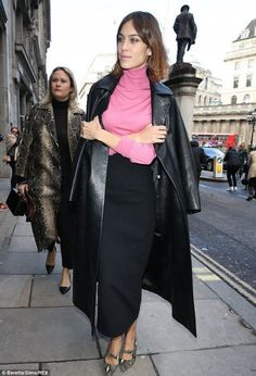 Alexa Chung bringing some shocking pink to her dark outfit.