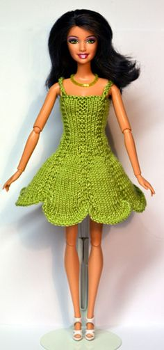 http://www.stickatillbarbie.se/ #1119 pattern has sweater too.