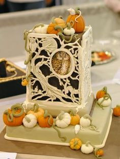 Gorgeous autumn cake with cutout cage work, sugar pumpkins and an owl peeking out. Really different.