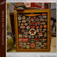 """Old gas station patches - collection of over 70 vintage patches from Shell, Texaco, Esso, Gulf, Flying A, Standard, and Gilmore Lion - 30"""" x 36"""" display box in solid oak"""