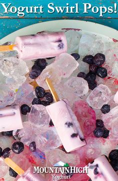 These 'Yogurt Swirl Pops' are the perfect way to cool down on a hot summer day. Click through to our website for instructions!  /  Ingredients: -3 cups Mountain High original/vanilla or low-fat yoghurt -1/4 cup strawberry preserves -1/4 cup fresh blueberries
