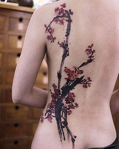Enchanting cherry blossom tattoo on the back. Brush stroke inspired, the simple strokes that make up the branches of the cherry blossom adds to the innocence and the beauty that the flowers denote.