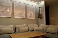 Salon with piano sheets with notes and guitar on the wall