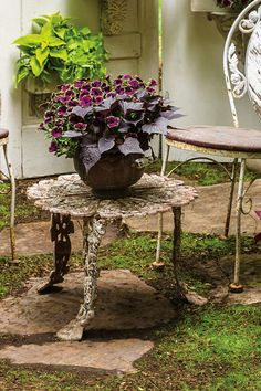 The dark tones of the plant combination shown here contrasts nicely with the aged patina of the wrought iron table. Unique, European heavy cast metal pieces will last forever and will only get more beautiful with time.