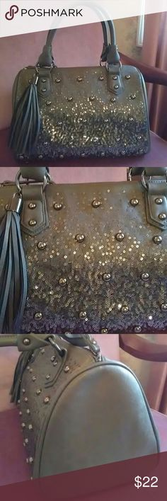 """Charming Purse NWOT Pewter Grey with Silver sparkles and Silvertone studs. Roomy Two handle handbag. Great for evening or a day you feel a little daring.measures 12"""" wide x 8"""" deep.Body of purse o"""" high.Zippers shut. Large tassel on purse . Price needs to be firm on this item. Charming Charlies Bags Satchels"""