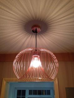 Nice wire light from b and q, not too modern to match in with your sofas etc