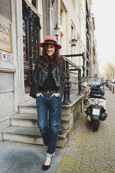 Andy Torres of Style Scrapbook wears a wide-brimmed fedora, leather jacket, and boyfriend jeans // #StreetStyle #Fashion