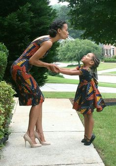 mother and daughter in African print