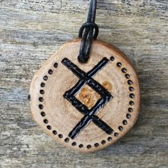 Ingwaz, the rune of the Norse God Freyr brings strength in adversity and protection to home and hearth.  Pinned by and available at TheWitchChandlery on Etsy