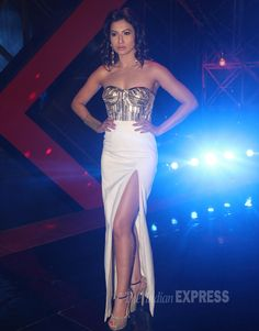 Host Gauhar (Gauahar) Khan was all decked up in a strapless Swapnil Shinde creation with a thigh-high slit on the sets of 'India's Raw Stars'.