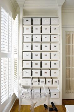 This homeowner paired white boxes with small instant photos of the shoes contained within for labels.