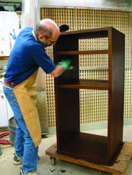 When staining wood, wipe wood stain instead of brushing for best results. Bob Flexner shows you how to apply stain to get great results in wood finishing.