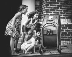 Picture of little girls yelling into an electric fan
