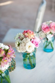 Vintage blue mason jars with pink and white floral charity maurer photography