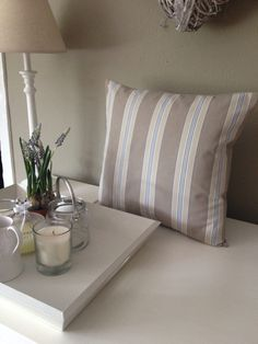 Beige & Blue striped cushion