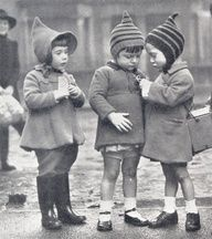 During the Blitz, many children were evacuated out of the cities to safer places in the country. These children here, from East London, seem to be checking out their curious identification labels.