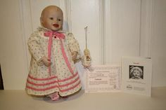 """set of 2 'Sarah' a Yolanda Bello porcelain doll by Ashton Drake Galleries. Porcelain head/limbs with stuffed body. Doll is 13.5"""" and # 7129A from 1987, ornament is poly/resin ADG 96816 from 1993. Doll comes with COA and she has green eyes with blonde hair. She is dressed in a pink nightgown with bunny slippers. **She is missing her hat and teddy bear** $40.00 FREE SHIPPING"""