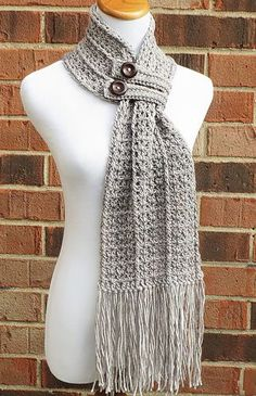 The Hartford Buttoned Scarf is a beautiful, lacy scarf featuring a unique construction, extra-long fringe and two trendy button bands to keep it snug and cozy! Made to match my Hartford Slouch Hat pattern, this scarf uses less than one skein of yarn, so it works up much quicker than the average scarf!