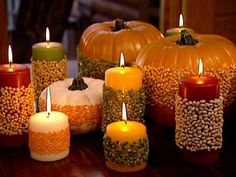 Way to decorate candles - use double sided tape to attach grains & oats!