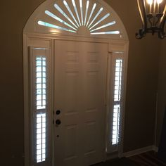 Plantation shutter sidelites with traditional tilt and movable arch. Designed and installed by Blinds, Shutters and More LLC of Niceville, FL