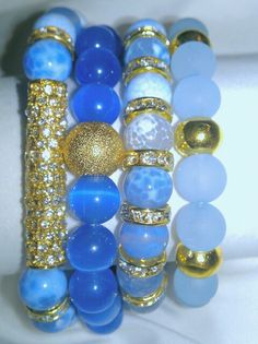 N'Genious Creations - BLUE GEMSTONE BRACELET SET (GOLD TONE), $50.00 (http://www.ngeniouscreations.com/blue-gemstone-mix-bracelet-gold-tone/)