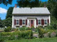 cute Cape Code style, like the English garden effect in the front yard as well