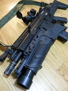 SCAR with EGLM grenade launcher and third party maker polymer ammo magazine. All black rather than flat dark earth, so maybe early or prototype  jdm