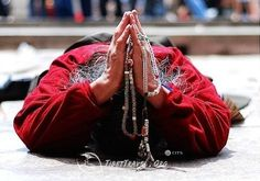Prostrating Tibetan pilgrim.