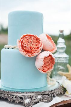 Blue beachy wedding cake with rope and peony accents. Cake Design: Amy Beck Cake Design