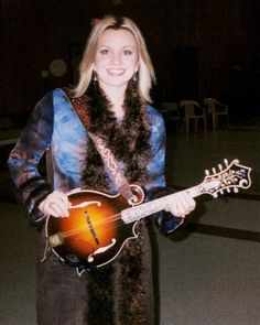 "Sonya Isaacs at Galax, VA with The Isaacs and her custom Artist Limited Edition strap, with Swarovski crystal letters, featuring carved, tooled shoulder piece with the ""S-Vine"" design (originated and carved by CT Strickland with design rights owned by Sonya Isaacs Yeary)."